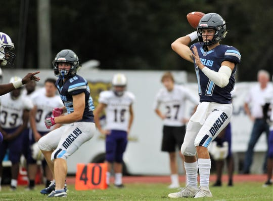 Maclay senior quarterback Brecht Heuchan throws a pass as the Marauders beat Marianna 51-30 on Monday, Oct. 21, 2019, during a make-up of a Friday postponement.