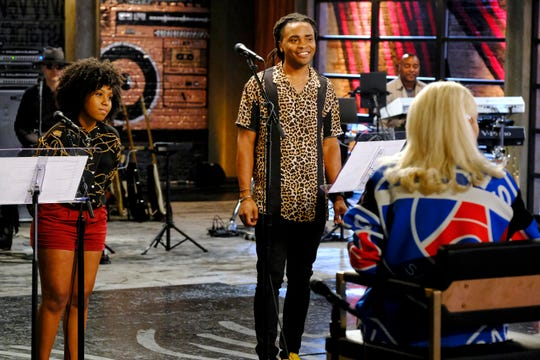 "Tallahassee's Royce Lovett, right, and his opponent, Kiara Brown, left, work with their coach, Gwen Stefani, in Episode 1709 of ""The Voice – Battle Reality."""