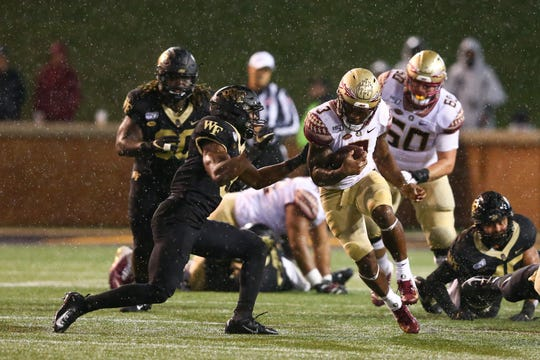 Florida State Seminoles running back Cam Akers (3) carries the ball during the fourth quarter against the Wake Forest Demon Deacons at BB&T Field.