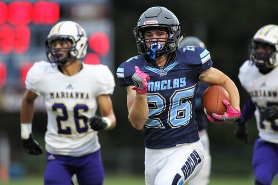 Maclay freshman Rhyder Poppell takes off on a 60-yard run to set up a touchdown as the Marauders beat Marianna 51-30 on Monday, Oct. 21, 2019, during a make-up of a Friday postponement.
