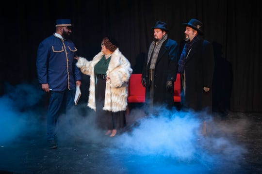 "Mrs. Hubbard (Jessica St. Hill) checks in with conductor, Michel (Sachin Murthy), while Monsieur Bouc (Scott Mock) and Hercule Poirot (Jake Armstrong) look on in Theatre Tallahassee production of ""Murder on the Orient Express."""
