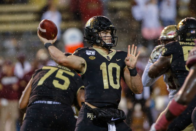 Wake Forest quarterback Sam Hartman looks to pass against Florida State in the second half of an NCAA college football game in Winston-Salem, N.C., Saturday, Oct. 19, 2019. (AP Photo/Nell Redmond)