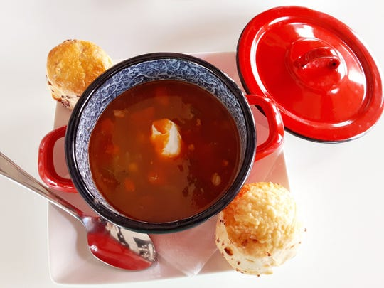 A cup of Hungarian goulash at Bomboloni Bakery & Cafe was served in a lidded crock. We added a Pogacha roll for dipping.