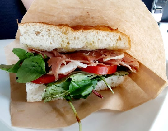 The prosciutto sandwich at Bomboloni Bakery & Cafe was accented with fresh mozzarella, tomatoes, mesclun mix, and buttery olive oil on light, airy focaccia bread.