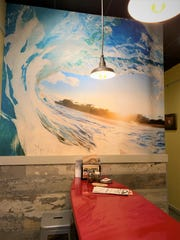 Tavola Pizza is decorated with mosaic surfboards on the walls and wave murals and paintings to get you in the mood to surf the menu at the Port St. Lucie eatery.