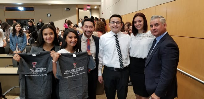 Bel Air High School Principal Charlie Garcia, third from left, and Ysleta ISD Superintendent Xavier De La Torre, right, stand with Bel Air students who were accepted into Texas Tech University Health Sciences Center El Paso's early-admission nursing program on Oct. 22, 2019.
