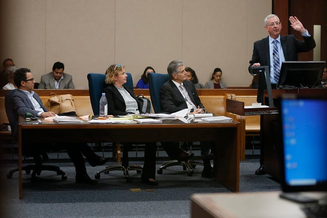Historic Preservationist Max Grossman, from left, attorney  Lisa Hobbs and Carlos Cardenas listen to attorney for the city, Mark Osborn; right, of Kemp Smith LLP, during the Duranguito neighborhood demolition ban court hearing Tuesday, Oct. 22, at the courthouse in El Paso.