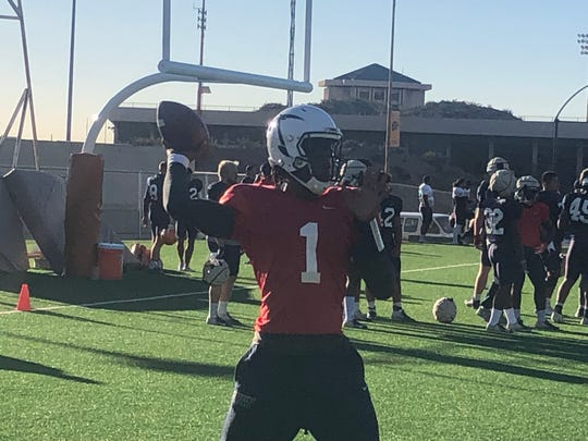 UTEP quarterback Kai Locksley warms up during Tuesday's practice at Glory Field