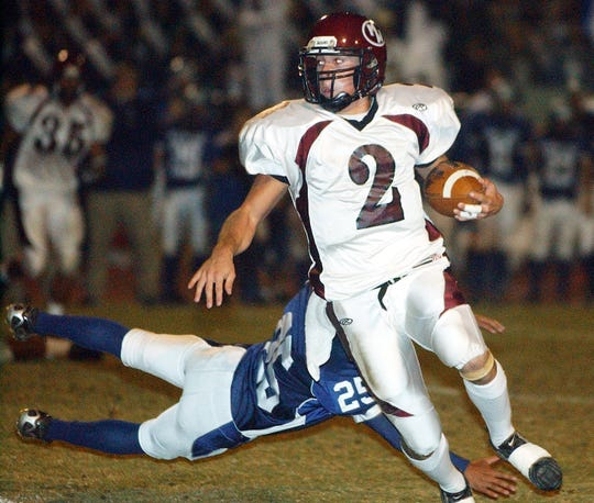 Mt. Whitney's Matt Jackson runs against Redwood at the 52nd annual Cowhide game at Giant Chevrolet-Cadillac Mineral King Bowl at Redwood High School in 2006.