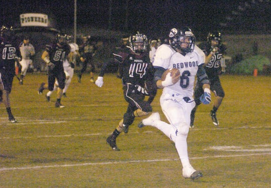 Redwood's Estevan Sausedo  runs for a touchdown against Mt. Whitney in the fourth quarter during the Cowhide game at Mineral King Bowl on November 13, 2009.