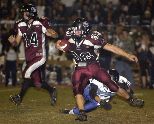 Mt. Whitney's Ben Bowen, 33, runs past the Redwood defense during the Cowhide game on Nov. 2.