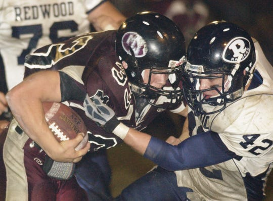 Mt. Whitney's Ben Bowen and Redwood's Kevin Barthelemy collide in the Cowhide game on Friday, November 2, 2007.