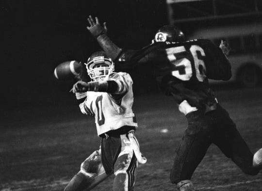 Mt. Whitney quarterback Chris Mendonca prepares to throw a pass against Redwood during the 1982 Cowhide Game.