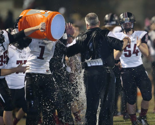 A Mt. Whitney player douses Pioneers head coach Marty Martin in the annual Cowhide game at Giant Chevrolet-Cadillac Mineral King Bowl on Friday, November 2, 2012.