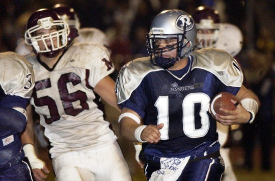 Redwood's Frankie Gonzalez runs against Mt. Whitney in the annual Cowhide game in 2004