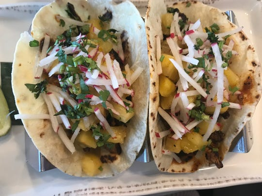 El Camino tacos are wrapped in grilled flour tortillas, but you can still ask for corn.