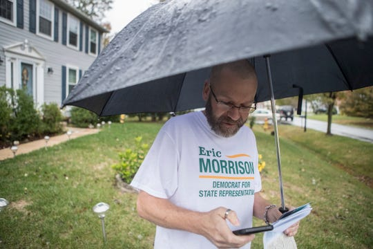 Democratic candidate for State Representative in the 27th District Eric Morrison goes door knocking on Terra Drive in Newark Tuesday night. Morrison says he would be Delaware's first openly gay to represent in the General Assembly if elected.