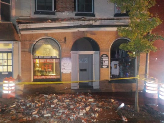 A building wall collapsing on South State Street in Dover.