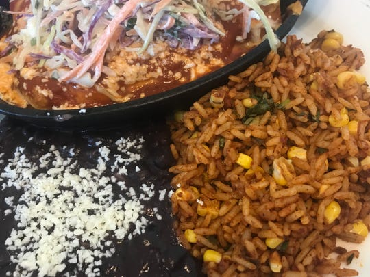 The portion sizes are more than amble at El Camino Mexican Kitchen. This is the short rib enchilada served with rice and black beans.