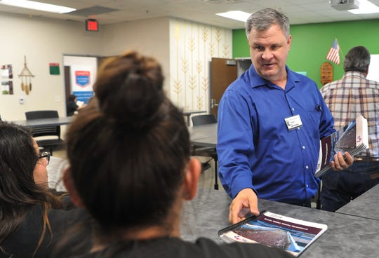 City of Wichita Falls Utilities Director, Daniel Nix hands out reading material during a class he helps teach at the WFISD Career Education Center about utilities management, Tuesday afternoon.