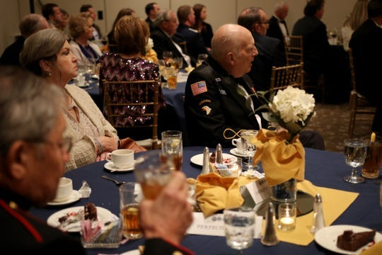 In this file photo, attendees of the 2018 military appreciation ball listen to that year's guest speaker Sen. Mac Thornberry. This year's speaker will be Dana Bowman, a former Golden Parachute Team member.