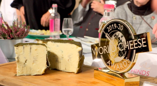 U.S. cave-aged blue cheese wrapped in grape leaves pleased the palates of international judges at the World Cheese Awards.