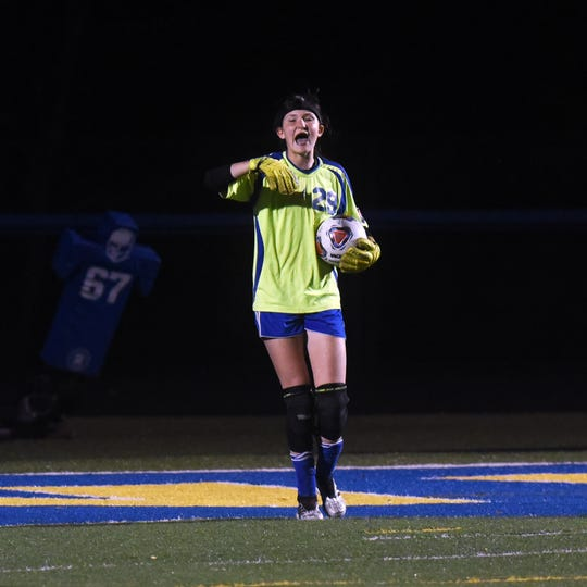 Rosecrans goalie Makaela McLaughlin yells out instruction during Rosecrans' win against Cambridge in the tournament. McLaughlin made first team All-Ohio in Division III.