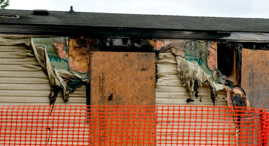 This photo taken April 7, 2019, shows melted vinyl siding hanging off the side of a trailer home at 14 Cypress Court in the Timberline Mobile Home Park northeast of Goodfield.