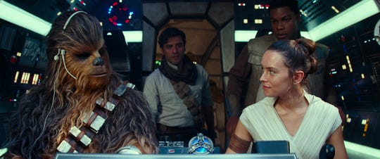 The gang's all here in the Millennium Falcon: Chewbacca (Joonas Suotamo, far left), Poe Dameron (Oscar Isaac), Rey (Daisy Ridley) and Finn (John Boyega).