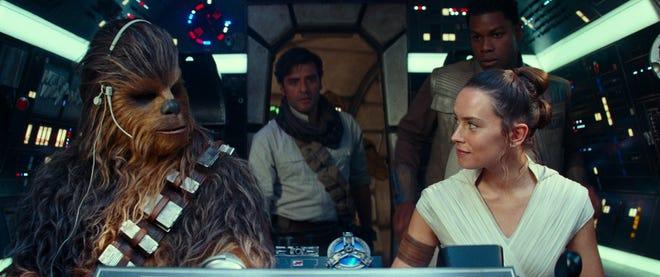 The gang's all here in the Millennium Falcon: Chewbacca (Joonas Suotamo, far left), Poe Dameron (Oscar Isaac), Rey (Daisy Ridley) and Finn (John Boyega).