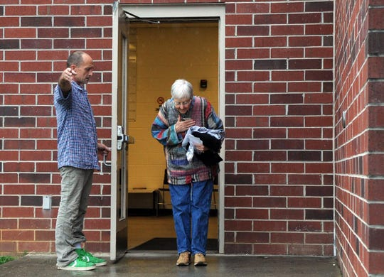 Michael Walli, left, points to the parking lot as Sister Megan Rice is released from the Blount County Detention Facility Friday, Aug. 3, 2012, in Maryville. Walli  sneaked into the Y-12 nuclear weapons plant on July 28, 2012.