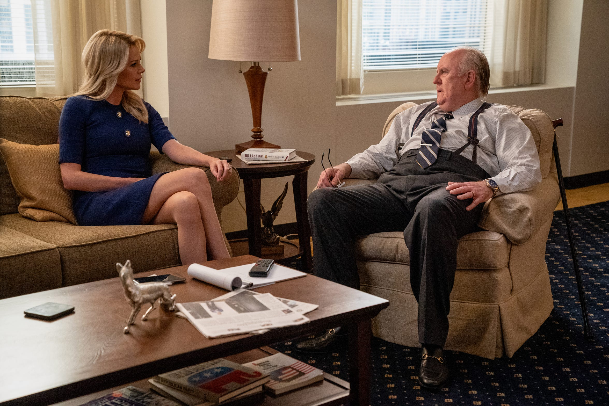 "Charlize Theron (left) stars as Fox News anchor Megyn Kelly in the film, ""Bombshell."""