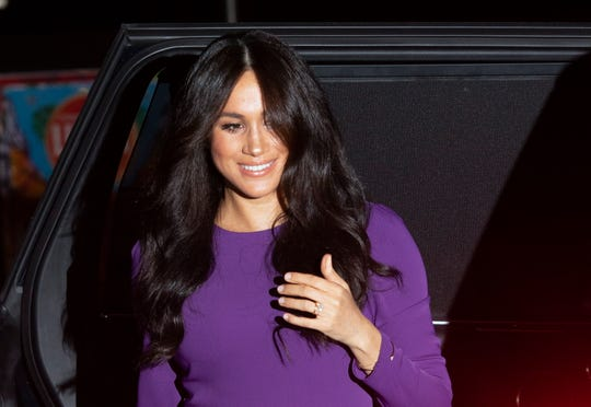 Duchess Meghan appears in public but will she and Prince Harry take time off from royal duties?