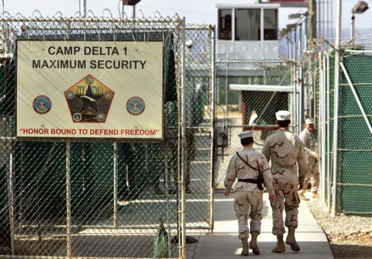 U.S. military guards walk within Camp Delta military-run prison, at the Guantanamo Bay U.S. Naval Base, Cuba.