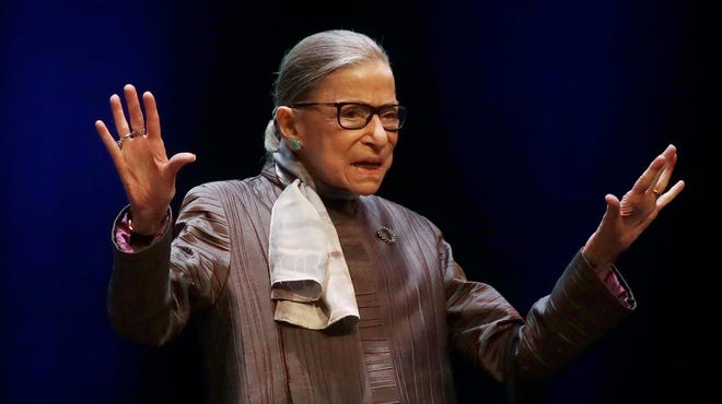 Supreme Court Justice Ruth Bader Ginsburg gestures while introduced during the inaugural Herma Hill Kay Memorial Lecture at the University of California at Berkeley, Oct. 21, 2019, in Berkeley, Calif.