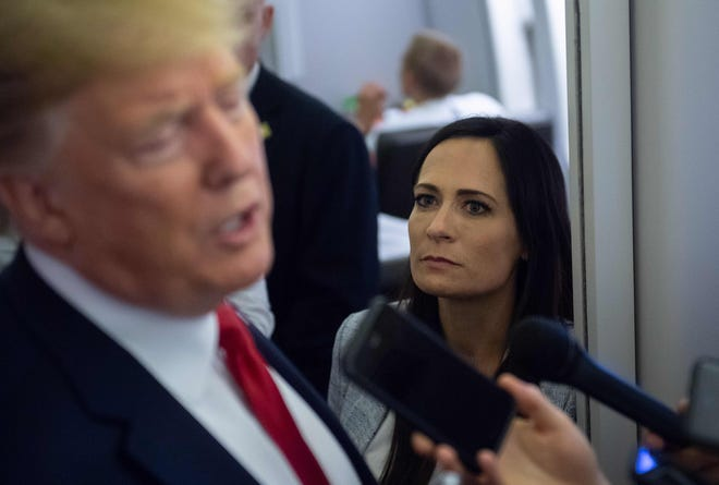 White House Press Secretary Stephanie Grisham listens to President Donald Trump