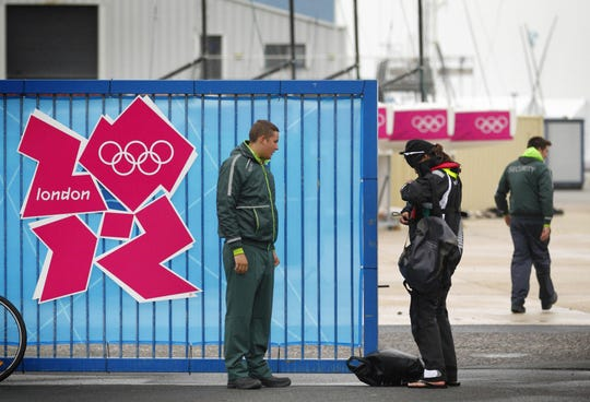 A G4S employed security guard checks an athlete's accreditation at the Weymouth and Portland Sailing Academy,