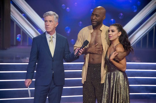 "Host Tom Bergeron stands with Karamo and Jenna Johnson as they learn their fate on ""DWTS."""