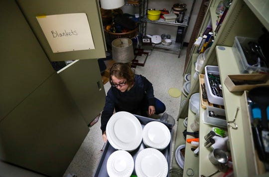 Shannon Anderson volunteers at Campus Cupboard and Closet on Monday, Oct. 21, 2019, at UW-Green Bay's Rose Hall. Campus Cupboard is for students who are having difficulty affording food on top of the cost of tuition, books, rent and other expenses.
