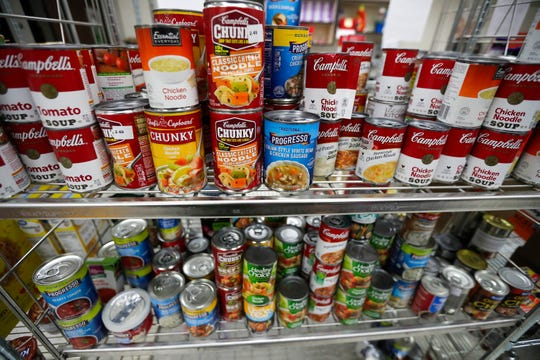 UW-Green Bay's Campus Cupboard is stocked with non-perishable food items like canned soup and vegetables pictured Monday, Oct. 21, 2019.