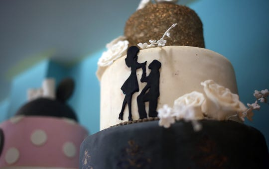 A sample wedding cake is on display. JenniCakes, a full-service bakeshop that has been in its current location in Lakehurst since December 2018, is celebrating 10 years in business this year.  Lakehurst, New Jersey. Wednesday, October 23, 2019. David Gard /Correspondent