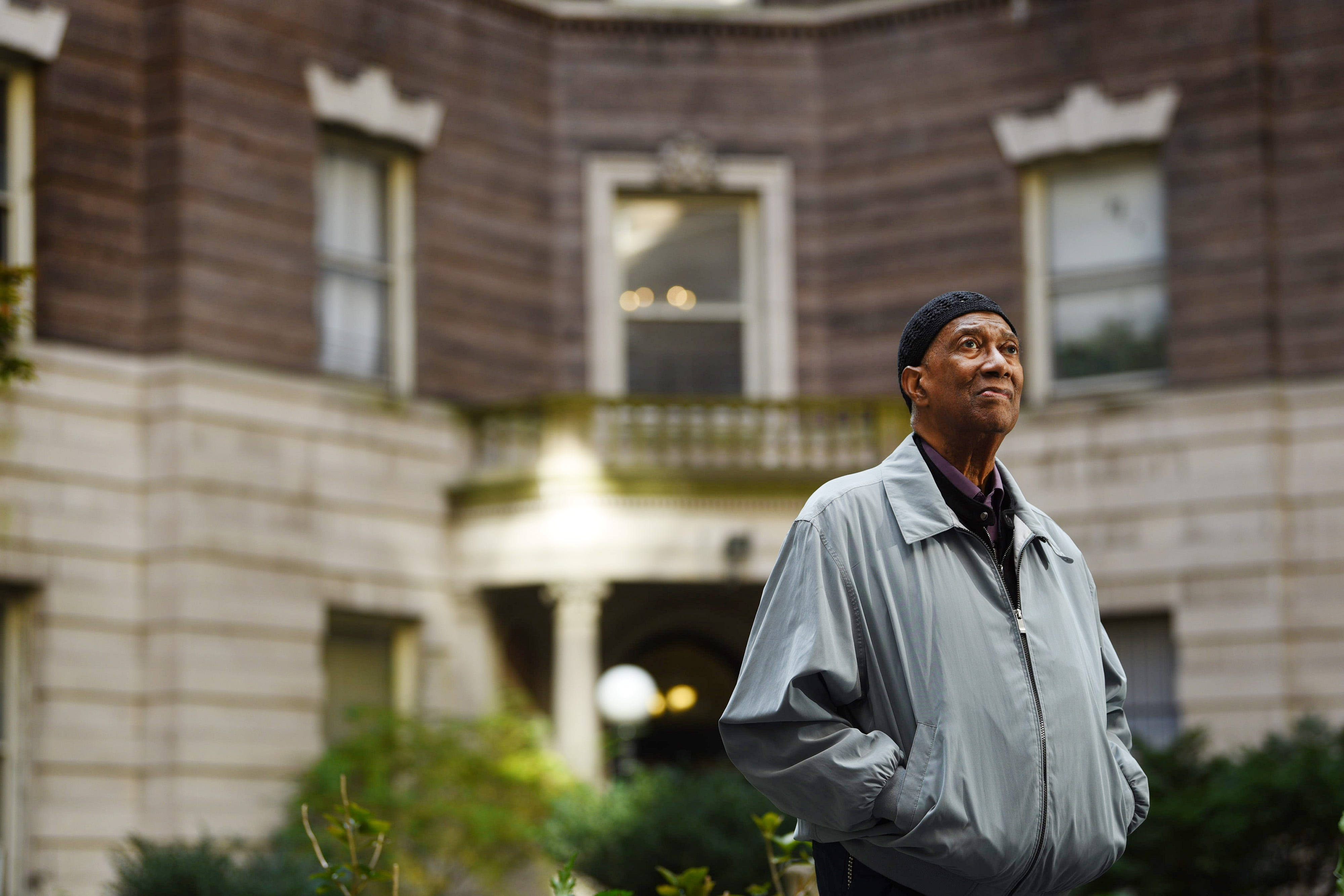 """Photo of Laconia Smedley, 83, a former president of the Graham Court tenants association, poses for a photo at the courtyard of Graham Court Apartments in Harlem on 10/23/19. The historic apartment building  was the setting for the 1991 film """"New Jack City."""""""