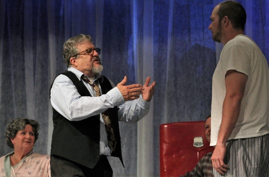 """Willy Loman (Gary Varner, left), pleads with his son Biff (Cody Baker) to take advantage of an opportunity in this rehearsal scene from """"Death of a Salesman."""""""