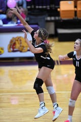 Wylie's Maggie Allen (14) finishes off a kill against Wichita Falls High at Bulldog Gym on Tuesday, Oct. 22, 2019. The Lady Bulldogs won 25-6, 25-12, 25-15 to hold onto second place in District 4-5A.