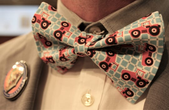 Justin Crowe, president of the Abilene Cultural Affairs Council board, debuted his Otis the Tractor bow tie at Wednesday's luncheon.