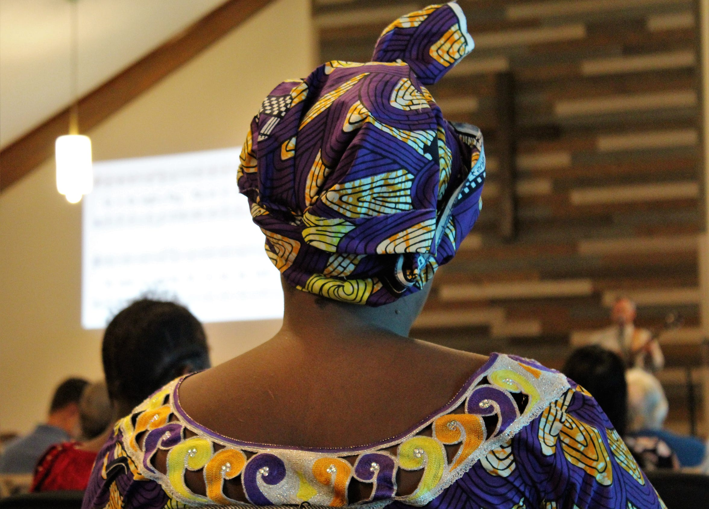 A woman in native dress attends an Elmcrest Baptist Church service Oct. 6. The church prints its bulletin in English, Swahili and French to be accessible to its congregation.