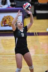 Wylie's Lexi Miller (11) sets the ball against Wichita Falls High at Bulldog Gym on Tuesday, Oct. 22, 2019. The Lady Bulldogs won 25-6, 25-12, 25-15 to hold onto second place in District 4-5A.