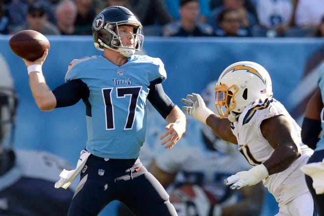 Tennessee Titans quarterback Ryan Tannehill (17) passes as he is pressured by Los Angeles Chargers defensive end Damion Square in the first half Sunday, Oct. 20, 2019, in Nashville, Tenn.