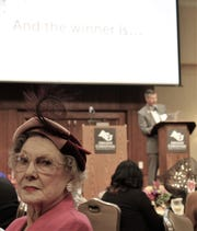 """And the winner is ... As for the arts, Evelyn Bein, 91, said Wednesday she """"likes them all, but I'm sort of a spectator now."""" Bein wore a """"vintage"""" hat to Wednesday's Celebrate the Arts in Abilene luncheon, for which Justin Crowe (background) was the host."""
