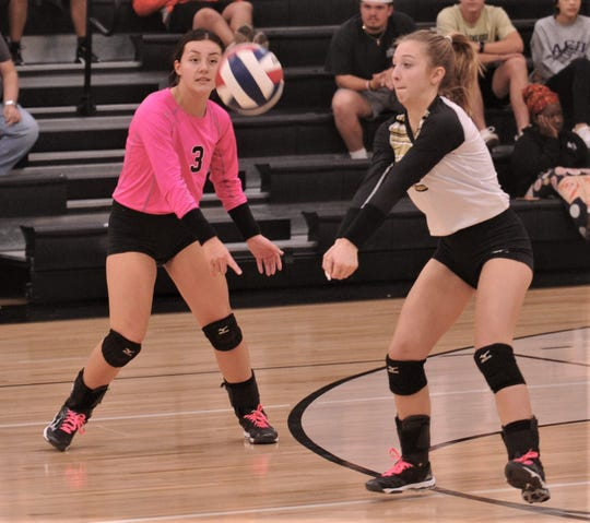 Abilene High's Alexis Wood, right, passes the ball while teammate Maddie Perez (3) looks on during their match against North Richland Hills Richland. Richland won the District 3-6A match 25-22, 25-16, 25-18 on Tuesday, Oct. 22, 2019, at Eagle Gym.